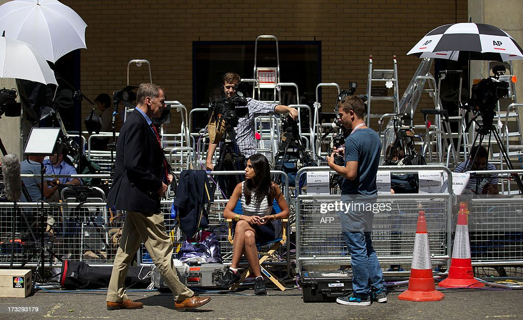 TV crews are photographed man their positions outside The Lindo Wing of Saint Mary's Hospital in Paddington, west London on July 11, 2013. Prince William and his wife Catherine's baby, which will be third in line to the throne, will be born in the private Lindo wing of St Mary's Hospital, where William was born in 1982 and his brother Harry in 1984.