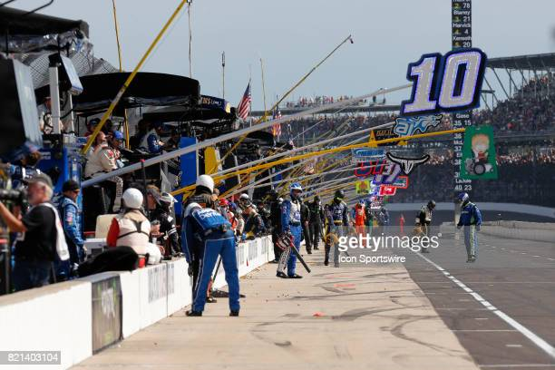 Crews clean out their pit stalls after a pit stop during the NASCAR Monster Energy Cup Series Brantley Gilbert Big Machine Brickyard 400 July 23 at...