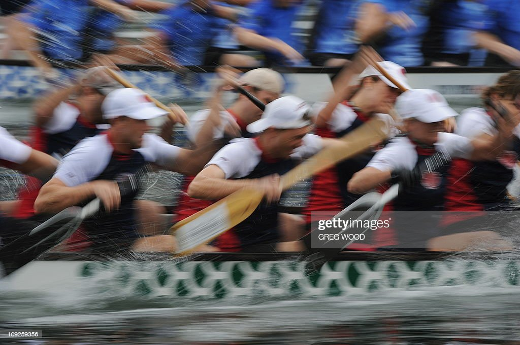 Crews compete in a Lunar New Year festival dragon boat race on Darling Harbour in Sydney on February 12, 2011. The event, held over two days and billed as the biggest meet in the southern hemisphere, sees more than 3,000 paddlers racing in brilliantly coloured dragon boats. AFP PHOTO / Greg WOOD