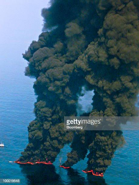 Crews conduct overflights of controlled burns taking place in the Gulf of Mexico US on May 19 2010 BP Plc took steps toward attempting to cap its...