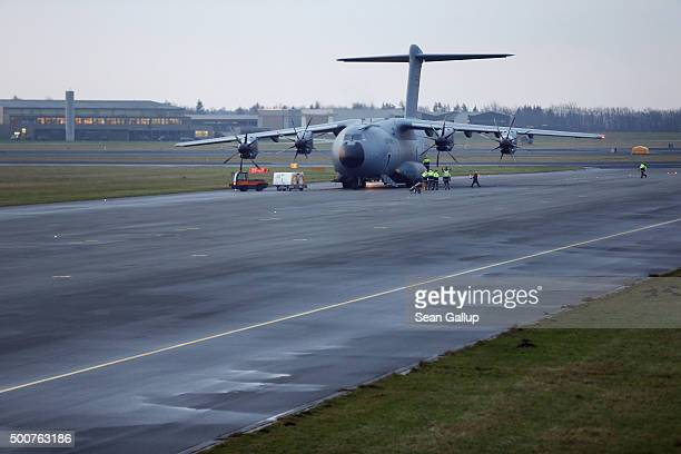 Crews load a Luftwaffe A400M plane transporting 40 Bundeswehr members and their equipment shortly before takeoff for Incirlik airbase in Turkey as...