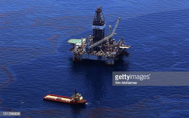 Crews on ships work on stopping the flow of oil at the source site of the Deepwater Horizon disaster on May 29 2010 in the Gulf of Mexico near Venice...