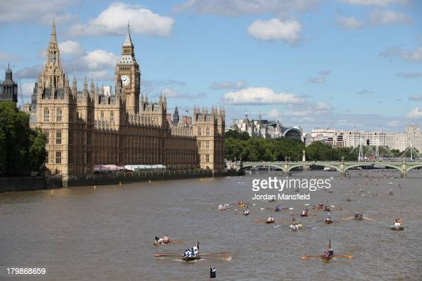 Crews pass the Houses of Parliament in the annual 'Great River Race' a 22 mile rowing race on the River Thames from the Docklands to Richmond on...
