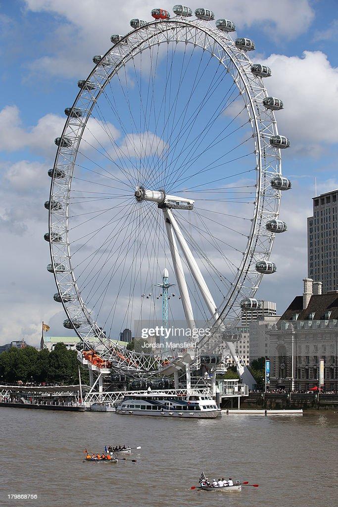 Crews pass the London Eye during the annual 'Great River Race' a 22 mile rowing race on the River Thames from the Docklands to Richmond on September...