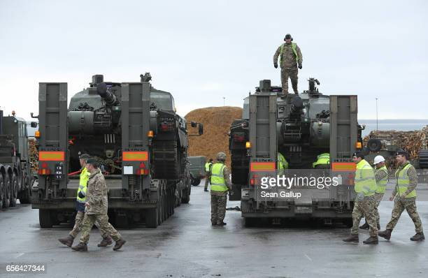 Crews prepare British Army Challenger 2 tanks of the 5th Battalion The Rifles for transport after the tanks and other heavy vehicles arrived by ship...