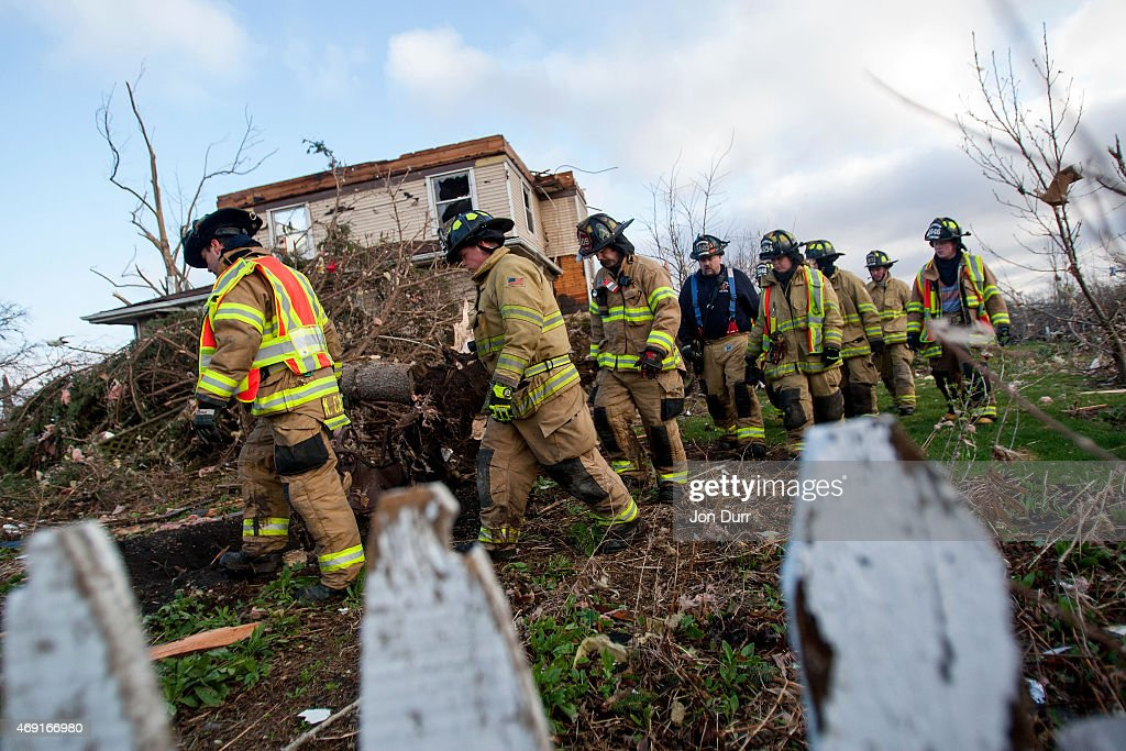 Crews search through the town for unaccounted people the morning after a tornado swept through the town on April 10 2015 in Fairdale Illinois...