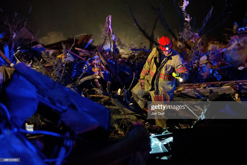 Crews search wreckage on the IL72 after a tornado came through the town earlier in the day on April 9 2015 in Fairdale Illinois According to reports...