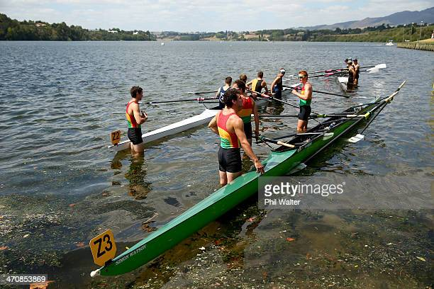 Crews stand with their boats in the lake during the Bankstream New Zealand Rowing Championships at Lake Karapiro on February 21 2014 in Cambridge New...