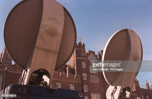 TV crews station themselves outside St James's Palace today where people have gathered in their thousands queueing for five or six hours to sign the...