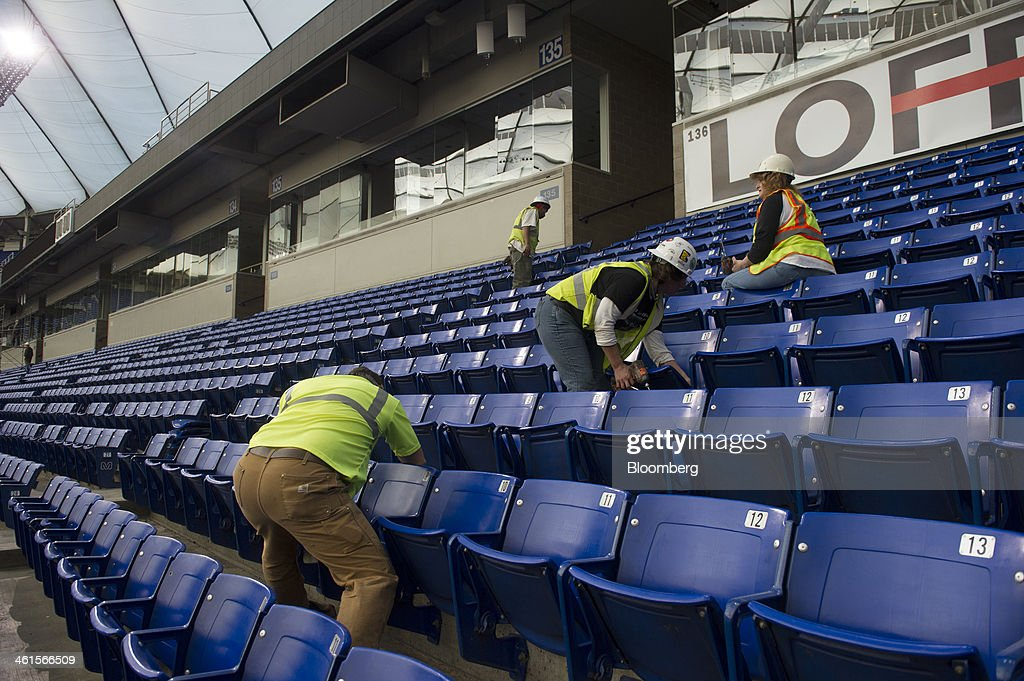 Crews tear out stadium seating during the demolition of the Hubert H. Humphrey Metrodome in Minneapolis, Minnesota, U.S., on Tuesday, Jan. 7, 2014. The new stadium is expected to generate development in downtown Minneapolis and provide a venue for national events such as the Super Bowl, said Michele Kelm-Helgen, chair of the Minnesota Sports Facilities Authority, which is overseeing the project at the site of the existing Metrodome. Photographer: Matthew Hintz/Bloomberg via Getty Images