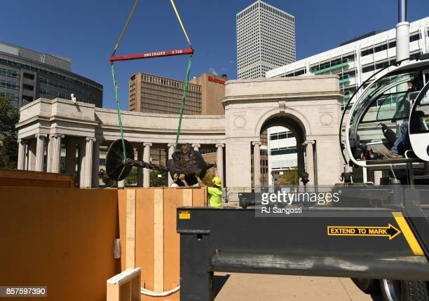 Crews work on the installation of Ai Weiweis internationally renowned Circle of Animals/Zodiac Heads at Civic Center Park on October 4 2017 in Denver...