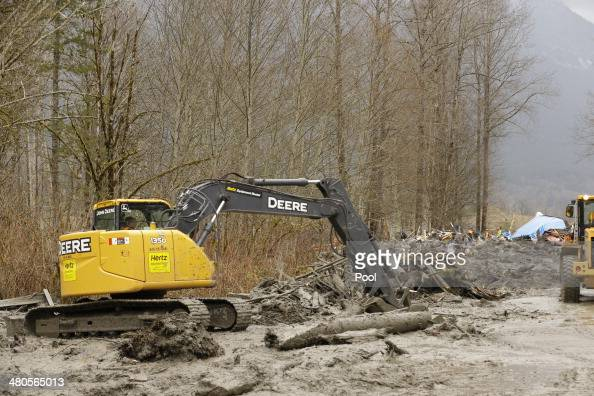 Crews work on Washington State Route 530 to clear debris from a mudslide on March 25 2014 in Oso Washington A massive mudslide on March 22 has killed...