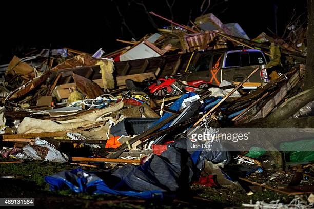 Crews work to clean debris on the IL72 after a tornado came through the town earlier in the day on April 9 2015 in Fairdale Illinois According to...