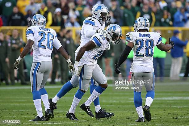 Crezdon Butler and Ezekiel Ansah of the Detroit Lions celebrate after Butler broke up the Green Bay Packers 2 point conversion attempt in the fourth...