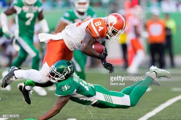 Crezdon Butler of the Saskatchewan Roughriders makes a tackle on Emmanuel Arceneaux of the BC Lions in the game between the BC Lions and the...