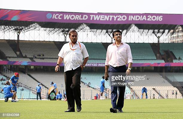 Cricket Association of Bengal president and former Indian captain Sourav Ganguly inspects the pitch with curator Sujan Mukherjee ahead of the ICC...