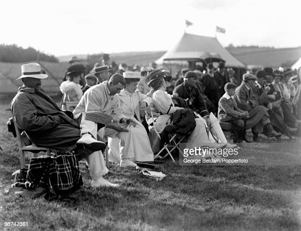 Cricket at Shillinglee Park Sussex and the scene around the boundary with Kumar Shri Ranjitsinhji and CB Fry who sits next to his wife Further to the...