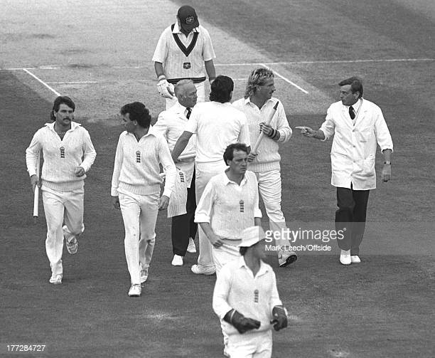 Cricket at The Oval England v Australia Umpire Dickie Bird appears to warn Ian Botham as he leaves the Oval pitch with a souvenir stump as Les Taylor...