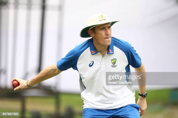 Cricket Australia CEO James Sutherland fields a ball during an Australian Test team nets session at SherE Bangla National Cricket Stadium on August...