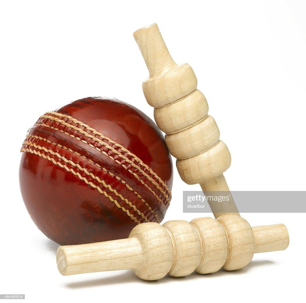 Cricket ball and bales : Stock Photo