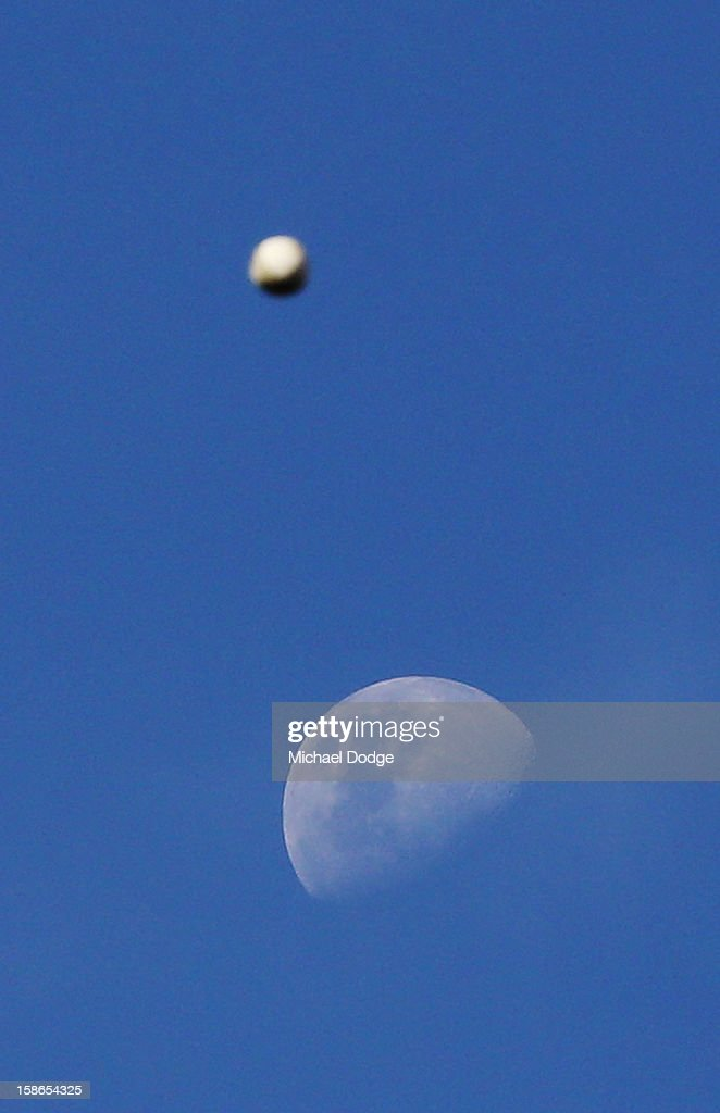 A cricket ball goes past the moon during practice before the Big Bash League match between the Melborune Renegades and the Brisbane Heat at Etihad Stadium on December 22, 2012 in Melbourne, Australia.