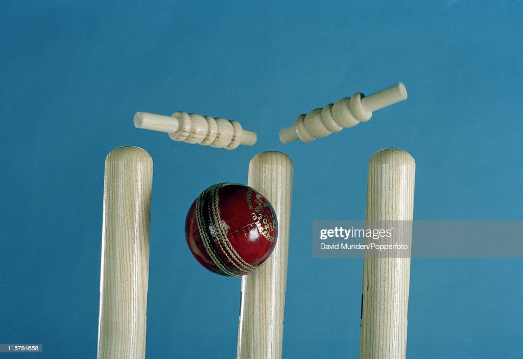 Cricket ball hitting the stumps and removing the bails 1st May 2011