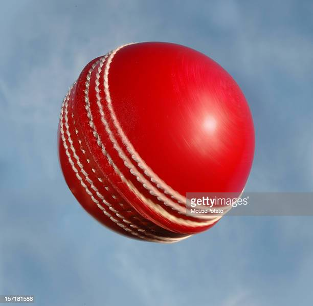 Cricket ball spinning against sky