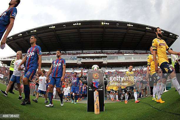 A cricket bat and cap are dislayed in the memory of Phil Hughes as players walk out onto the ground during the round eight ALeague match between the...