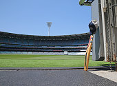 A cricket bat and cap left by a Cricket Victoria player sits in the players tunnel at the Melbourne Cricket Ground as people remember Phillip Hughes...