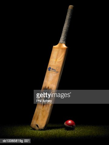 Cricket bat with hole and ball