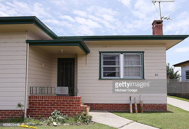 Cricket bats are rested in tribute to Phillip Hughes on an old weatherboard house on December 2 2014 in Macksville Australia Cricket player Phillip...