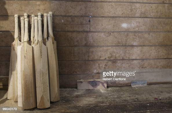 Cricket bats awaiting manufacture by craftsman Julian Milichamp are seen in his home studio on May 12 2010 in Drysdale Australia Milichamp has been a...