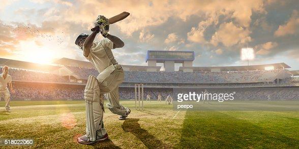 Cricket Batsman Hitting Ball During Cricket Match In Stadium