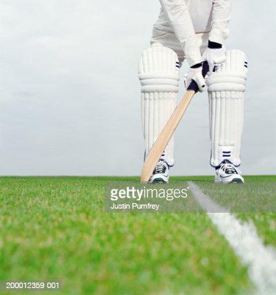 Cricket batsman preparing to bat, low section