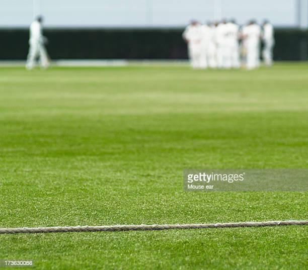 Límite de críquet de cuerda y a bateador