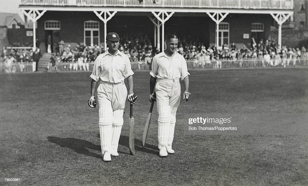 Cricket. Circa 1930+s. A picture of the legendary England batting pair of JB (John 'Jack' Berry) Hobbs (Surrey) and Herbert Sutcliffe (Yorkshire) walking out to bat at the Scarborough Cricket Festival. : News Photo