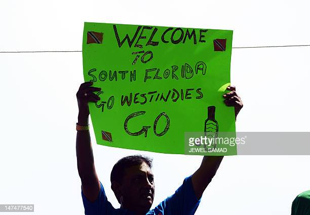 A cricket fan holds a placard during the first T20 match between West Indies and New Zealand at the Central Broward Regional Park Stadium Turf Ground...