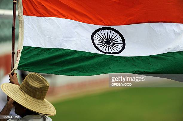 A cricket fan waves the flag of India during their oneday international cricket match against Sri Lanka in Adelaide on February 14 2012 IMAGE...