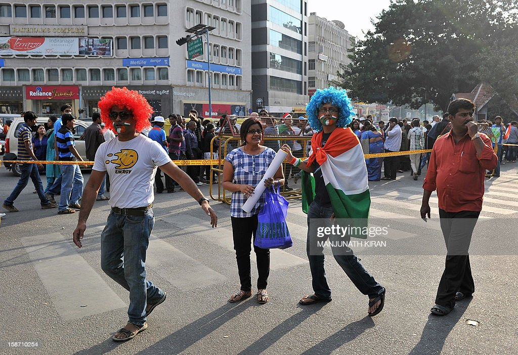 Cricket fans arrive outside The M. Chinnaswamy Stadium in Bangalore on December 25, 2012. Police were out in full force in the southern Indian city as part of a massive security operation ahead of Pakistan's first cricket tour of India for five years. AFP PHOTO/Manjunath KIRAN