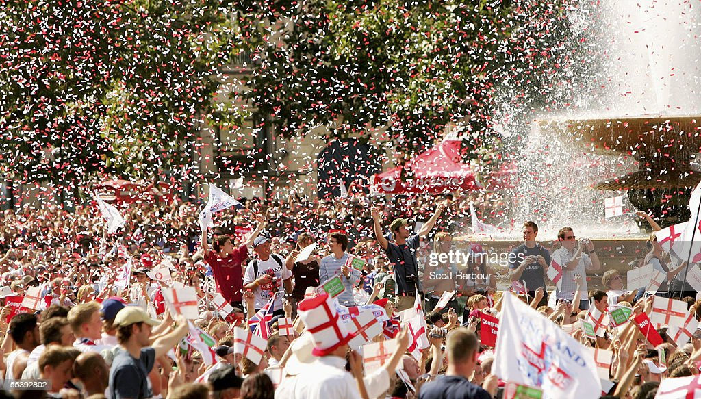 Cricket fans celebrate as the England Cricket team enter Trafalgar Square as part of the Ashes victory celebration on September 13 2005 in London...