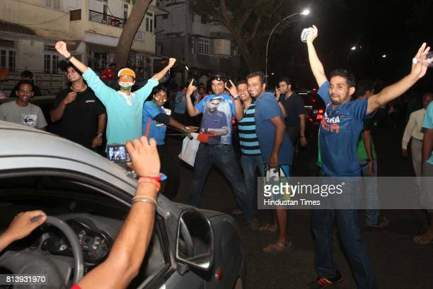 Cricket fans chanting slogans in favour of Sachin Tendulkar God of Cricketas they celebrate the victory of India against Sri Lanka in the final match...
