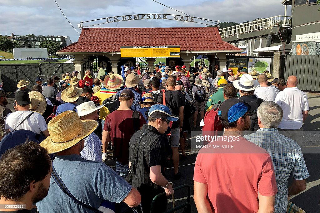 Cricket fans cue waiting to enter the Basin Reserve during day two of the first cricket Test match between New Zealand and Australia at the Basin Reserve in Wellington on February 13, 2016. / AFP / Marty Melville
