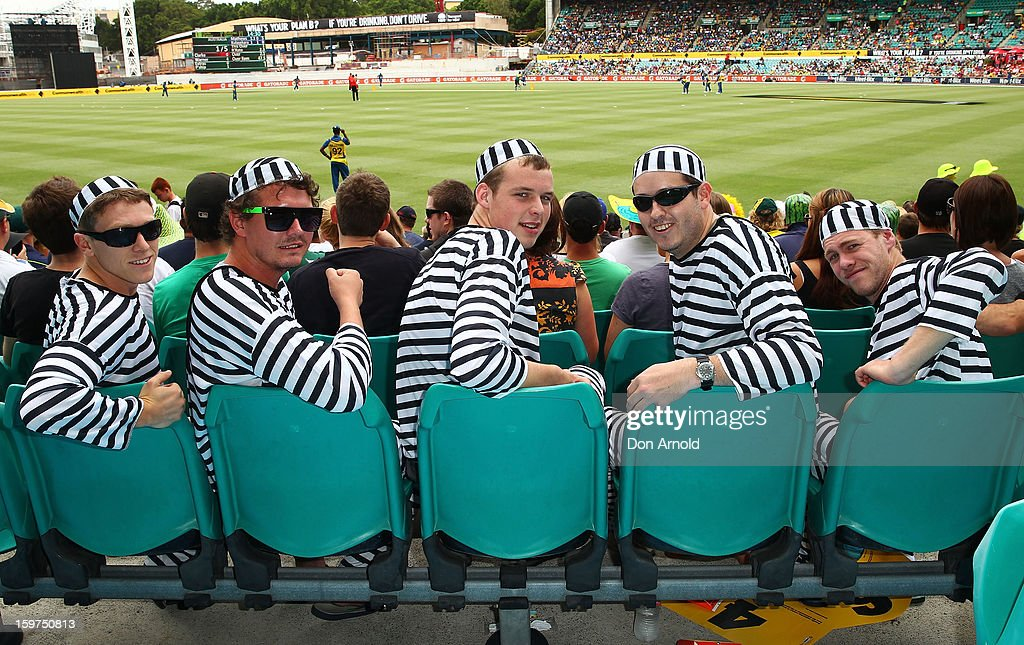 Cricket fans dressed up in costume look on during game four of the Commonwealth Bank one day international series between Australia and Sri Lanka at Sydney Cricket Ground on January 20, 2013 in Sydney, Australia.