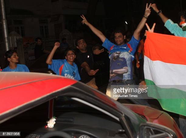 Cricket fans forcing the fans driving around to pay respect to the God of Cricket Sachin Tendulkar before going ahead