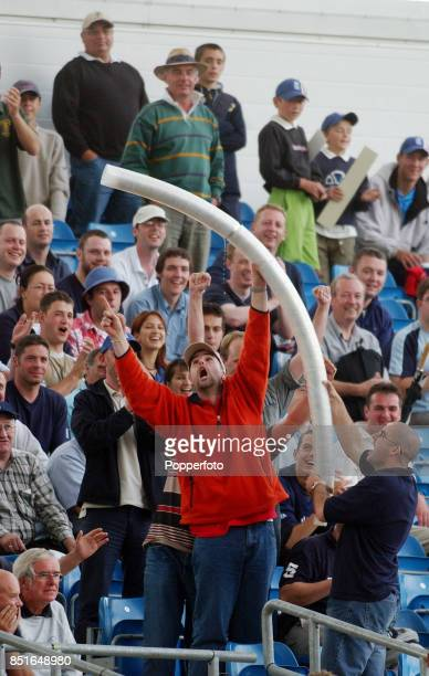 Cricket fans having fun as they gather the plastic beer glasses during the Third npower Test match between England and India on August 22 2002 at...