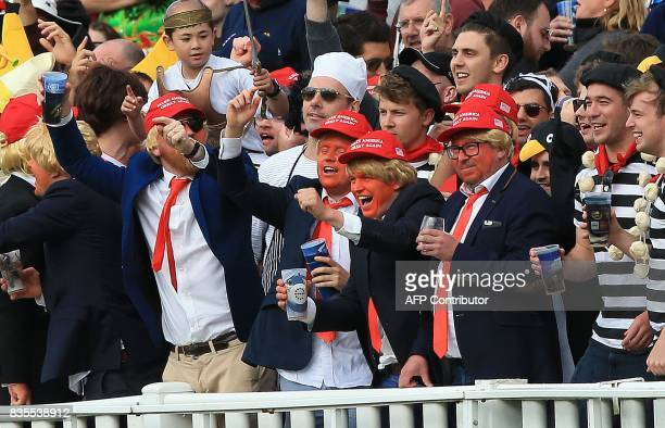 Cricket fans in costume mock American President Donald Trump during play on day 3 of the first Test cricket match between England and the West Indies...