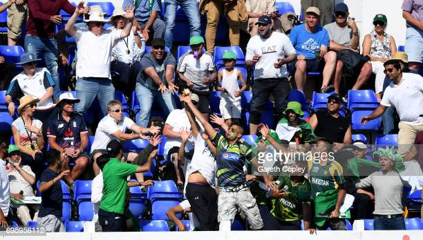 Cricket fans look to catch a six from Babar Azam of Pakistan during the ICC Champions Trophy Semi Final between England and Pakistan at SWALEC...