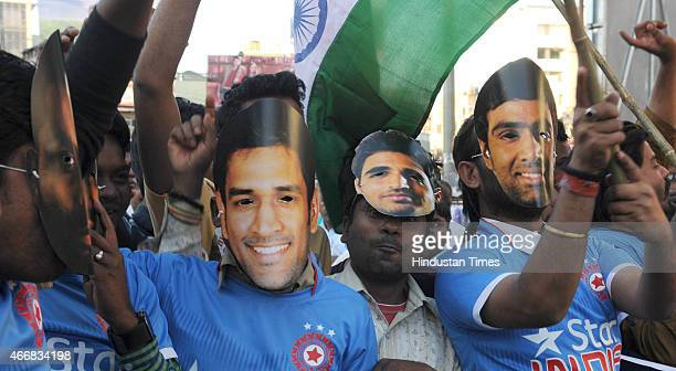 Cricket fans of the home town of team India Captain MS Dhoni celebrating the India team victory against Bangladesh in quarter final match of ongoing...