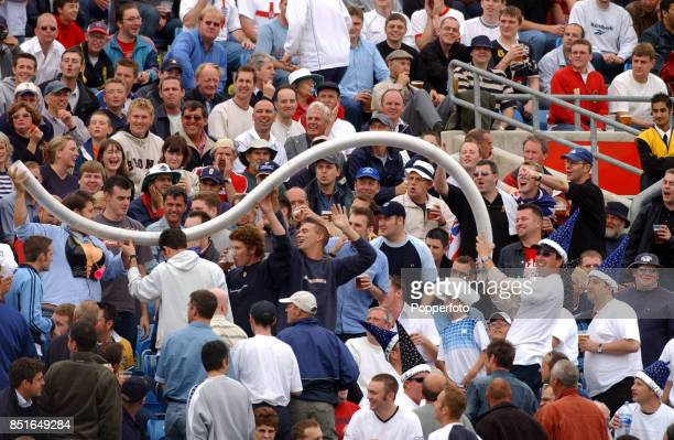 Cricket fans on the Western Terrace having fun as they gather the plastic beer glasses during the Third npower Test match between England and India...