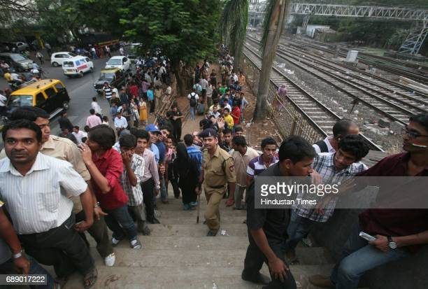 Cricket fans queue up outside Wankhede Stadium for tickets of the Friday match as Sachin plays on 67